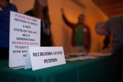 Local citizens and business owners sign a petition for the proposed recreation wellness center. Photos by Rasy Ran